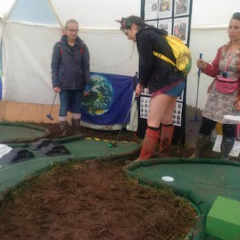 Golf in muddy conditions at Glastonbury festival